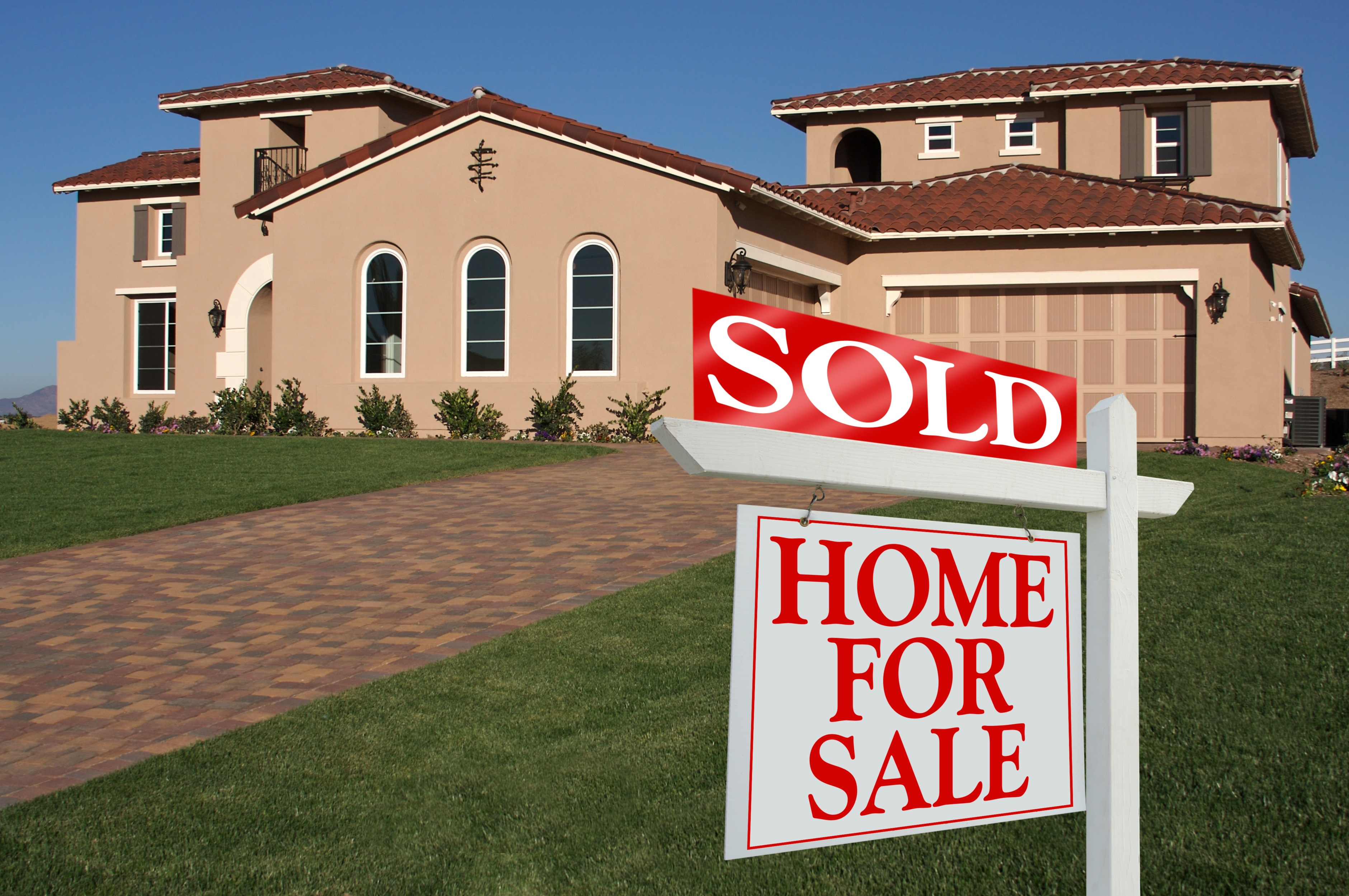 Sold Home For Sale Sign In Front Of New House.